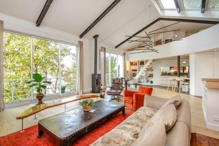 Salon séjour dans la maison design du 6 bis boulevard Paul-Emile Victor à Neuilly
