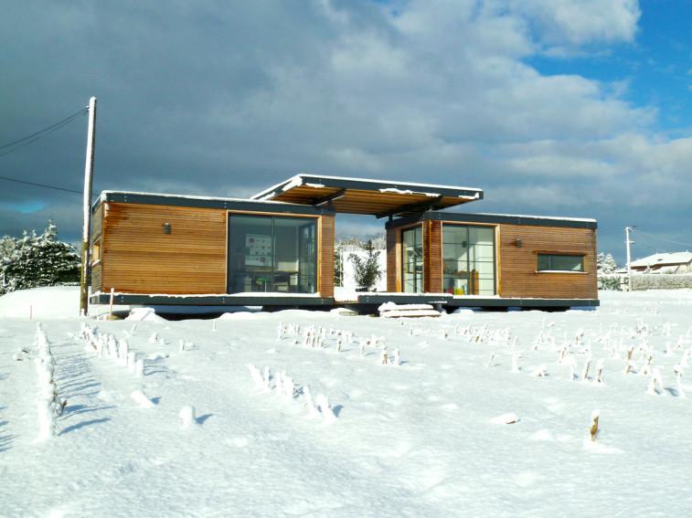 Maison en bois Iroko Evolutiv sous la neige
